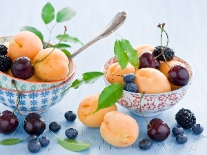 Bowls, cherries, apricots, blueberries