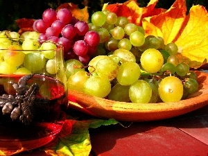 A glass, Grapes