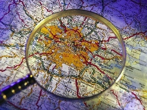 Map, magnifying glass, London