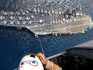 Planes, soldier, aircraft carrier