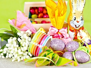Ribbons, eggs, rabbit, lilies, chocolate